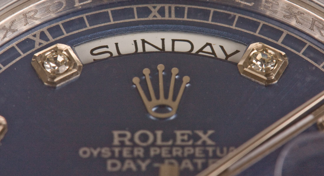 date window on fake Day Date watch dial