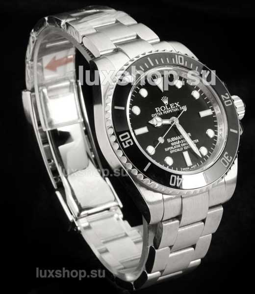 black rolex submariner image on dark background